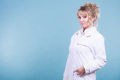 Middle aged female medical doctor. Female medical doctor in white professional uniform apron with blue stethoscope on her neck. Middle aged woman pharmacist Royalty Free Stock Image