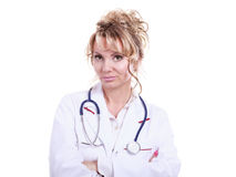Middle aged female medical doctor. Female medical doctor in white professional uniform apron with blue stethoscope on her neck. Middle aged woman pharmacist Royalty Free Stock Photography