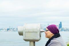 Middle Aged Female Using Public Telescope Royalty Free Stock Photography