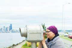 Middle Aged Female Using Public Telescope Stock Photos