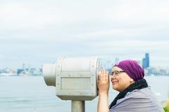 Middle Aged Female Using Public Telescope Royalty Free Stock Photo