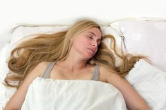 Middle age woman real portrait bed bedroom blonde long hair fifty plus copy space 50 blanket pillow face sleep fever sick stock photography