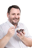 Middle aged guy is fond of a beet salad Royalty Free Stock Photos