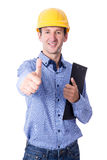 Middle aged handsome business man in yellow builder's helmet thu Royalty Free Stock Images