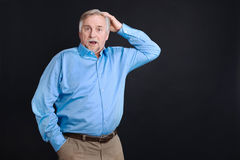 Middle-aged handsome man looking shocked Stock Photography