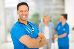 Middle aged health worker. Good looking middle aged health worker with arms crossed Stock Image