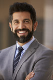 Middle aged Hispanic businessman smiling to camera, close up Stock Photography