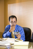 Middle-aged Hispanic businessman texting. Close-up of middle-aged Hispanic businessman staring at text message on mobile phone Stock Photo
