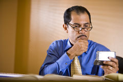 Middle-aged Hispanic businessman working in office Stock Photo