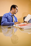 Middle-aged Hispanic businessman working in office Stock Image