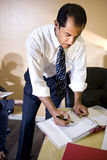 Middle-aged Hispanic businessman working in office Royalty Free Stock Photography