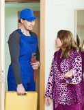 Middle-aged housewife meeting handsome worker Royalty Free Stock Photos