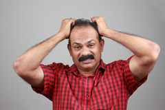 Middle aged Indian. Portrait of a middle aged depressed man Royalty Free Stock Image