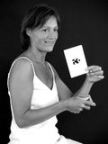 Middle aged lady. With the vital puzzle piece Royalty Free Stock Image