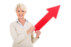 Middle aged lady direction arrow Royalty Free Stock Image