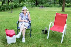 Middle Aged Lady Having A Picnic Lunch. Stock Photography