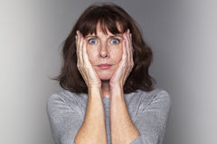 Middle aged lady with headache Royalty Free Stock Photo