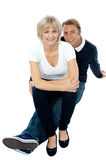 Middle aged lady sitting on her man's lap Stock Photography
