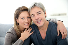 Middle-aged loving couple at home. Middle-aged couple relaxing on sofa at home Stock Image