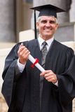 Middle aged male graduate Stock Photo