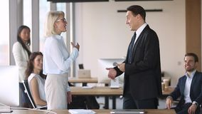Middle aged male manager promote congratulate handshake proud female employee. Middle aged male executive manager promote congratulate with career growth stock video