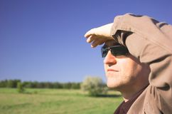 Middle-aged man. In sunglasses looking somewhere royalty free stock photo