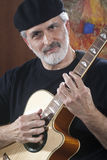 Middle-Aged Man With Acoustic Guitar Stock Images