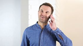 Middle Aged Man Answering Phone Call. High quality Stock Images