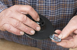 Middle-aged Man Assembling Sanding Disk Holder. Royalty Free Stock Photography