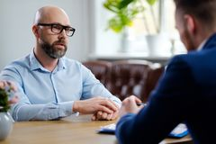 Middle-aged man attending job interview. Middle-aged men attending job interview stock photography