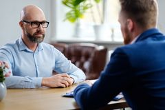 Middle-aged man attending job interview. Middle-aged men attending job interview royalty free stock image
