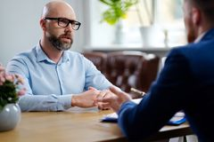 Middle-aged man attending job interview. Middle-aged men attending job interview royalty free stock images