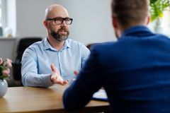 Middle-aged man attending job interview. Middle-aged men attending job interview stock images