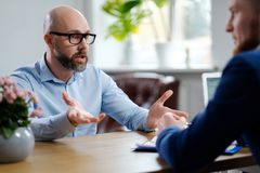 Middle-aged man attending job interview. Middle-aged men attending job interview stock photos