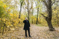 A middle-aged man in the Autumn Park. Stock Photo
