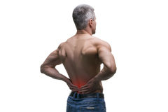 Middle aged man with back pain, muscular male body, studio isolated shot on white background. With red dot Stock Images