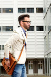 Middle aged man with bag walking outdoors Royalty Free Stock Photos