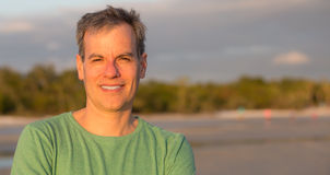 Middle aged man at the beach royalty free stock images