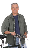 Middle Aged Man With Bicycle Stock Image
