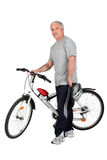 Middle-aged man with bike Royalty Free Stock Photos