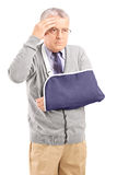 Middle aged man with a broken arm Stock Photos