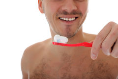 Middle aged man brushing his teeth Royalty Free Stock Image