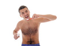 Middle aged man brushing his teeth in the morning Royalty Free Stock Images