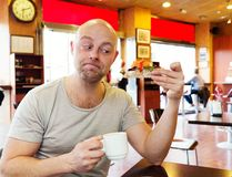 Middle-aged man in a cafe Royalty Free Stock Image