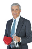 Middle aged Man with Champagne and Red Heart Stock Image