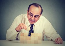 Concentrated mature man building a business royalty free stock images
