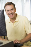Middle aged man on a computer Stock Photos