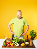 Middle-aged man cook fresh salad Royalty Free Stock Photography