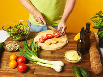 Middle-aged man cook fresh salad Stock Images