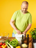 Middle-aged man cook fresh salad Stock Photography